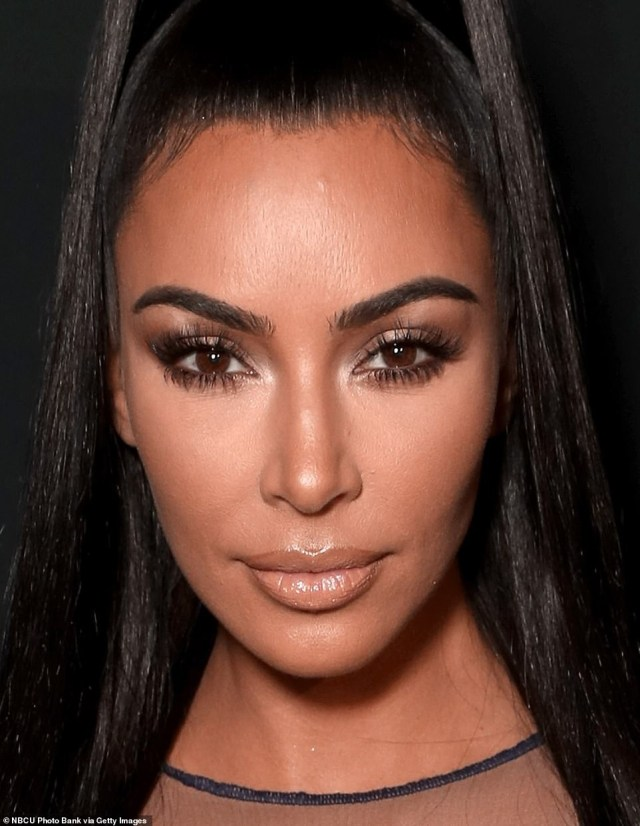 Kim Kardashian flaunts her curves in a nude see-through dress to 2018 People