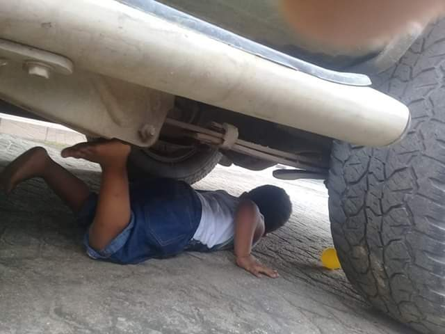 Photos: Nigerian man almost crushed his young son to death with his car