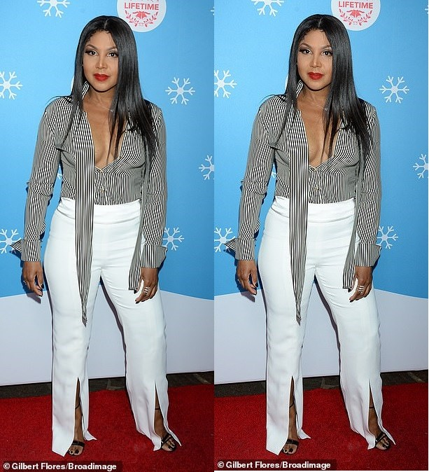 Toni Braxton nearly surfers a wardrobe malfunction as she steps out braless in plunging blouse (Photos)