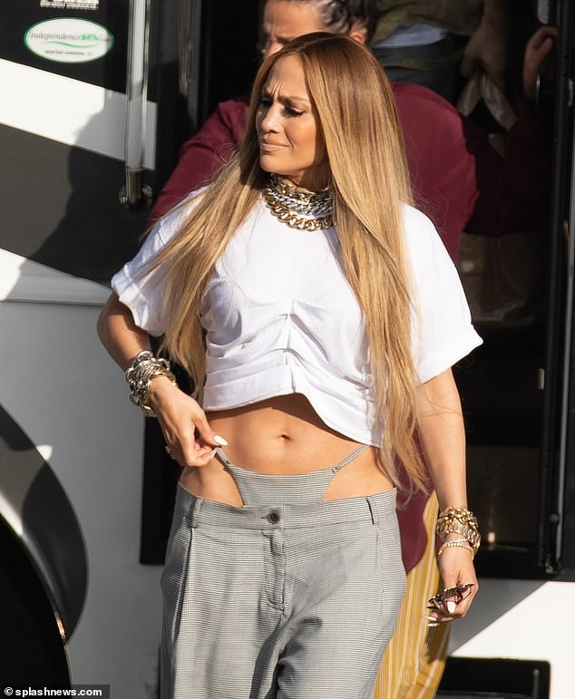 See the drop-waist trousers with tailor-made thong Jennifer Lopez was pictured wearing on set of her music video (Photos)