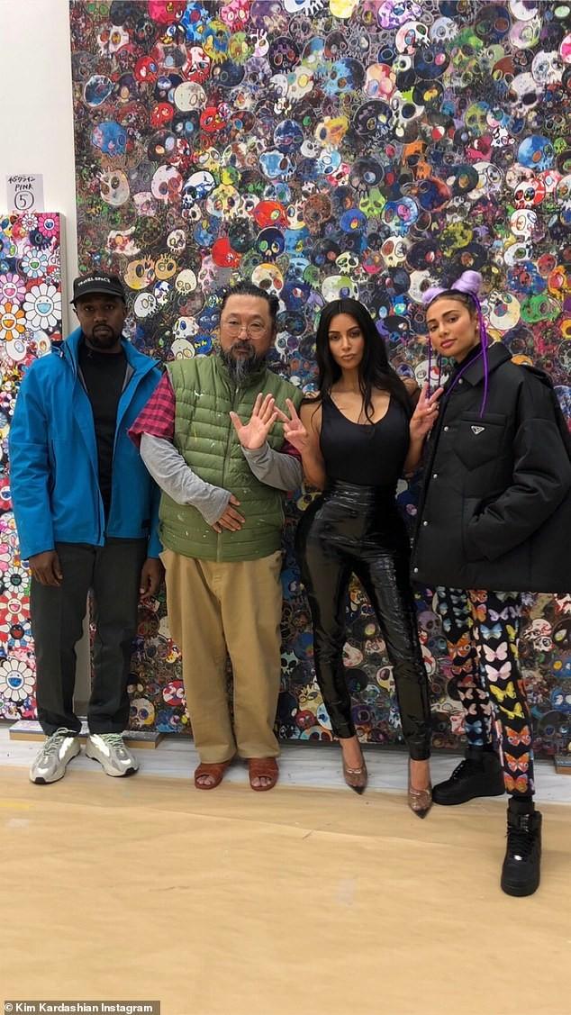 Kim Kardashian and Kanye West strike a pose with famous artist Takashi Murakami in Tokyo (Photos)