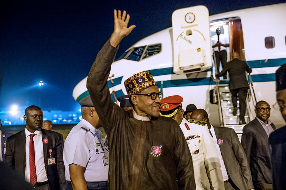 [photos] Mohammadu Buhari returns to Abuja from Poland