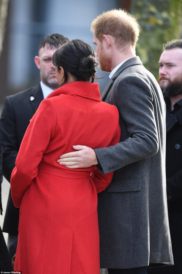 Meghan Markle lets slip her baby will arrive in April as she and Harry arrive in Birkenhead