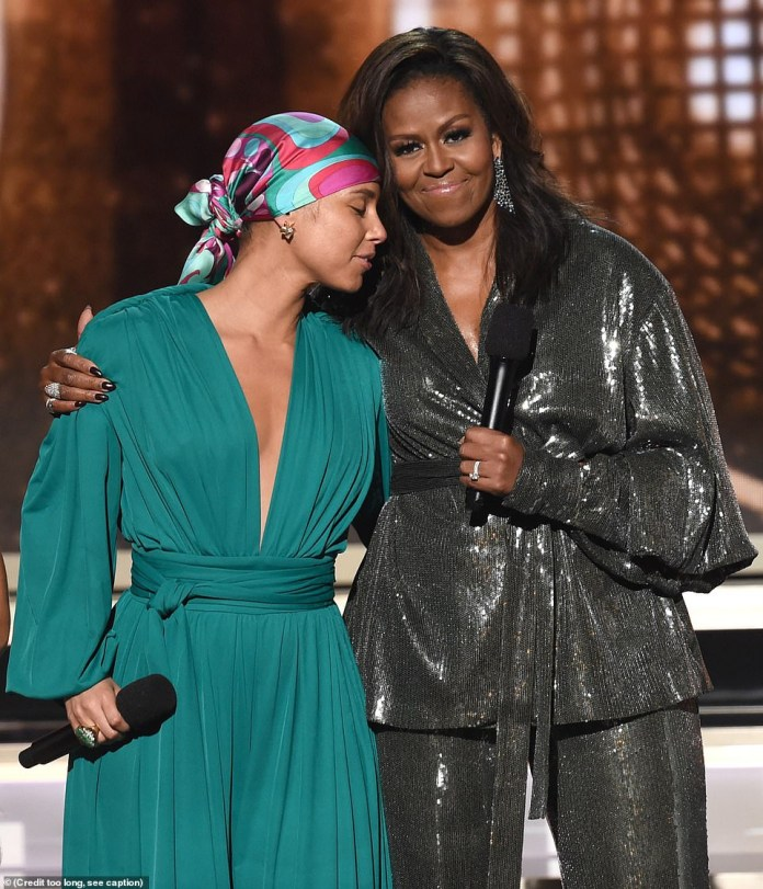 Michelle Obama makes surprise appearance at the Grammys, joining Alicia Keys, Jennifer Lopez, Jada Pinkett, and Lady Gaga on stage