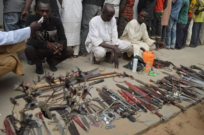 Photos: Police arrest 50 political thugs over attack on innocent passersby during PDP Presidential Campaign in Kano; seize haul of dangerous weapons