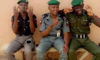 IG orders investigation into photo of police officers doing President Buhari's 4+4 sign