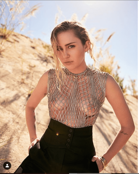Miley Cyrus shocks her followers as she flaunts her nipples in see-through chain top (Photo)