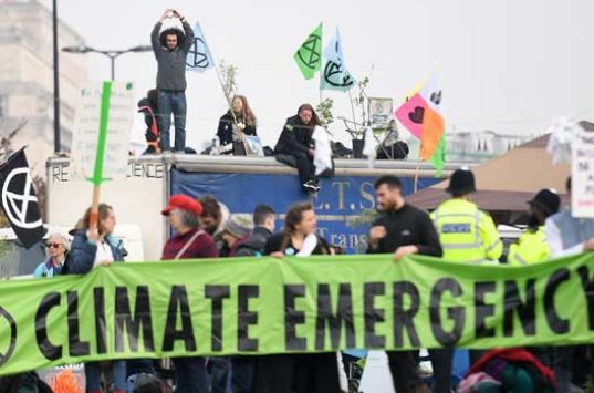 Over 100 people arrested at London climate change protests