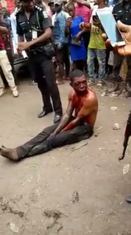 Photos/Videos: Notorious car thief nabbed and brutally beaten by irate mob in Abuja