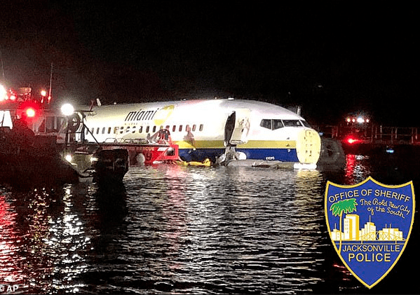 No lives lost as military plane carrying 143 people skids off the runway and crashes into a river while landing at Jacksonville airport