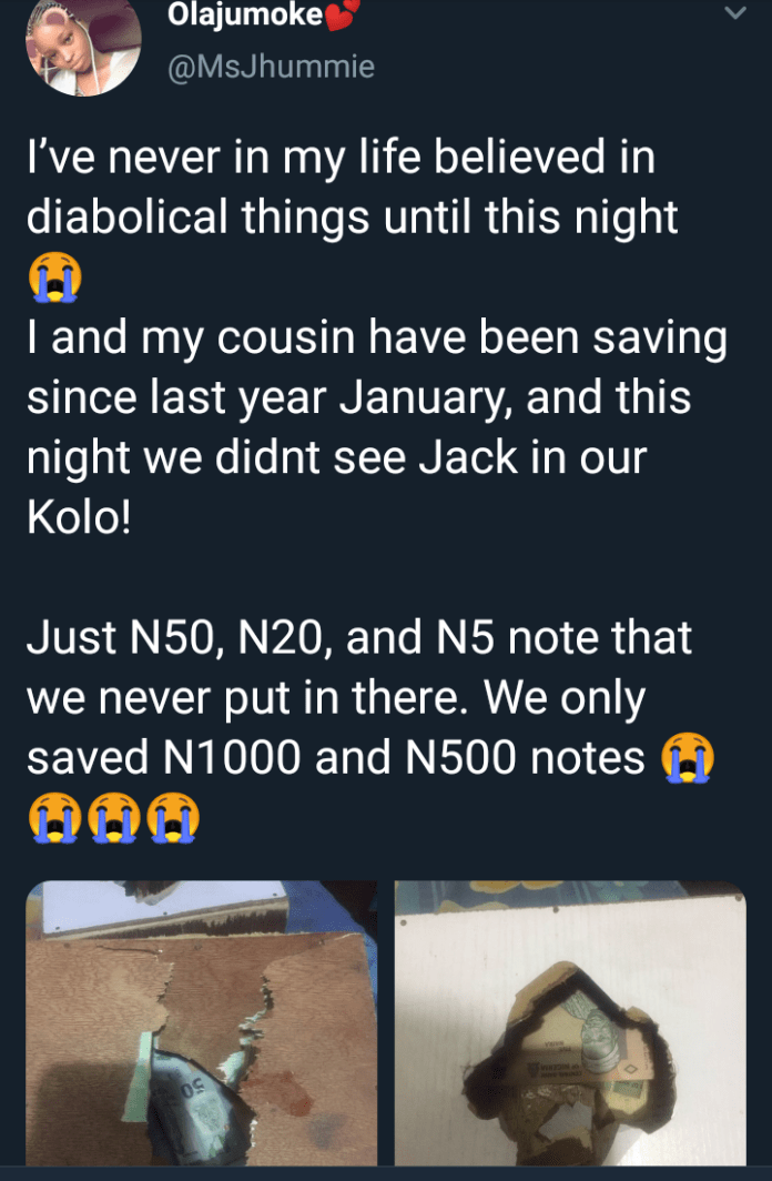 Nigerian lady is in shock after saving money in her piggy bank for over a year only to find a paltry sum when she broke it open