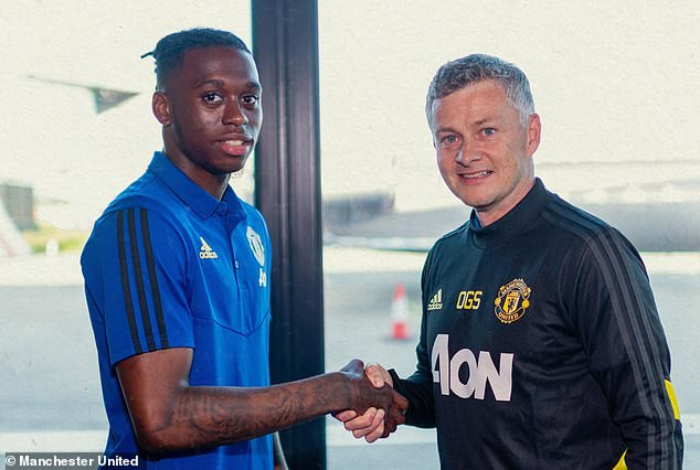 Manchester United complete ?50m signing of Aaron Wan-Bissaka from Crystal Palace and he