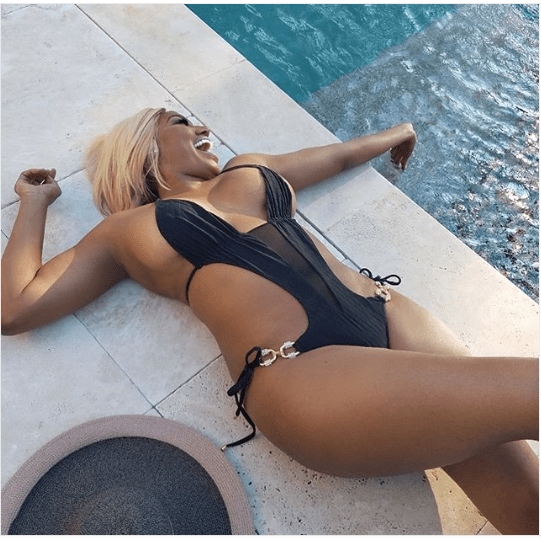Reality star NeNe Leakes shows off her banging body in tiny black bathing suit (Photos)