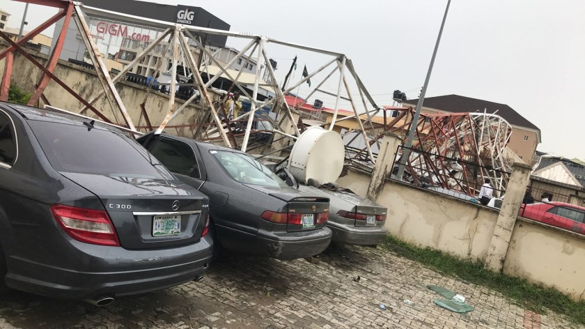 Aerial mast collapses in Abuja, destroy cars