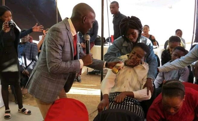 PHOTOS: Prophet shares alcohol as communion in church 2