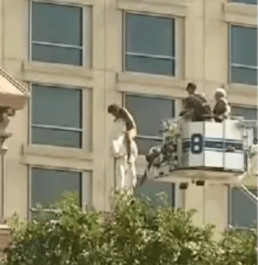 Stark naked woman climbs the roof of a cathedral and straddles statue for more than 4 hours (video)