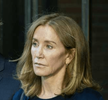 Actress Felicity Huffman begins her prison term