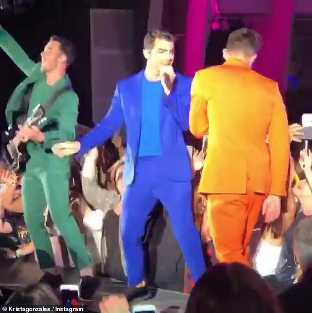 Moment overzealous female fan tries to grab Nick Jonas