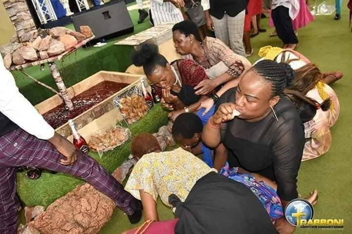 PHOTOS: South African pastor feeds members with millipedes and Beer