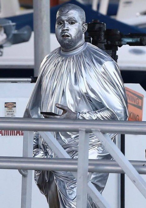 Kanye West covered in head-to-toe chrome as he performs in Miami