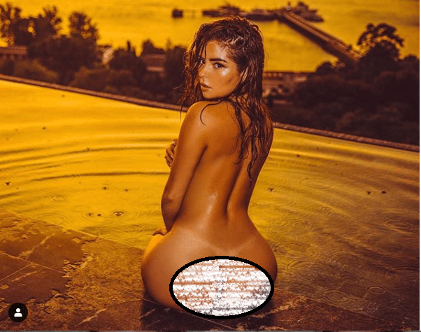 British model, Demi Rose shows off her bare backside as she poses nude in new photos