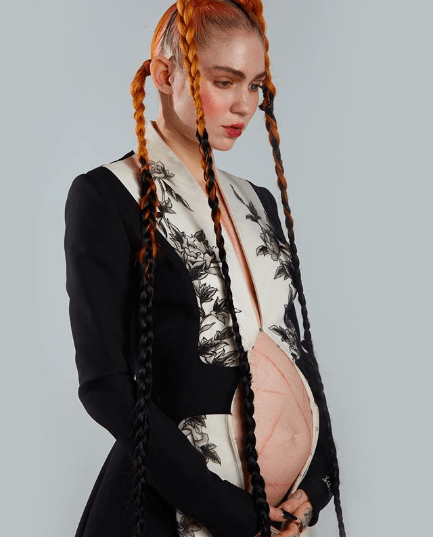 Grimes releases another photo of her bare baby bump amid speculations she