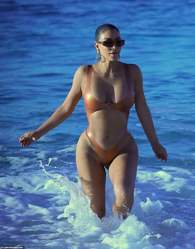 Kim Kardashian showcases her curves in skimpy monokini as she hits the beach in Mexico