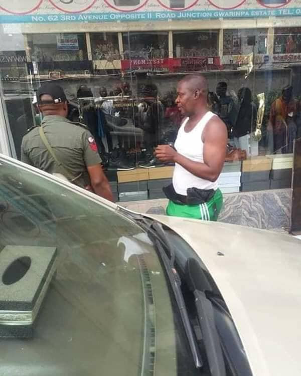 Well-dressed man nabbed after hiding cloth he stole from an Abuja boutique in his underwear (photos)