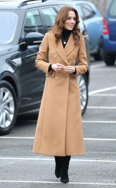 Kate Middleton wears a similar coat to Meghan Markle