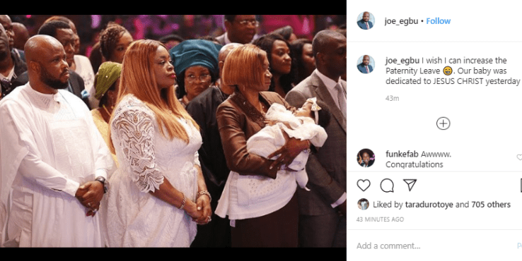 Sinach and her husband dedicate their child in church during mid-week service