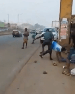 Anambra task force officials seen dragging trader on the floor and pulling out daggers (video)