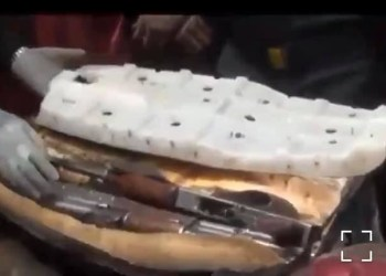 AK-47 rifles and magazines found hidden in a motorcycle seat (video)