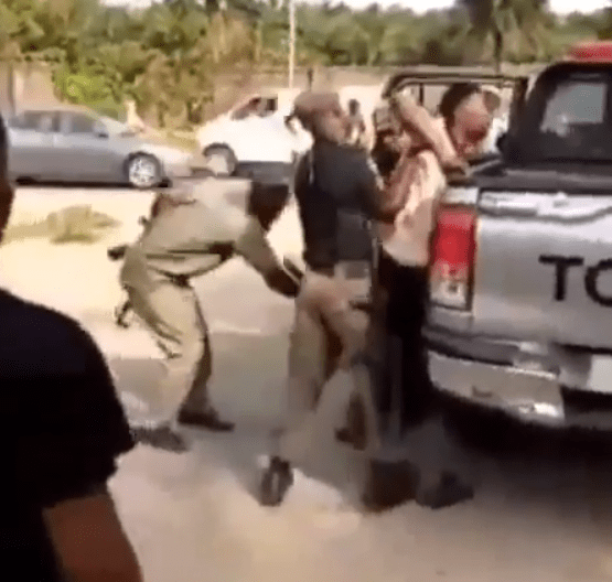 Nigerian Man Shares Video Of His Brother Being Beaten By Police Officers While On His Way To Visit His Mother In Delta State (Video)