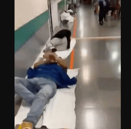 Inside hospital where coughing coronavirus patients lay on floor of corridor (video)