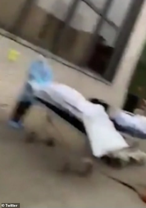 Dead bodies loaded into refrigerated trucks outside New York hospitals after 98 people die from coronavirus in seven hours (video)