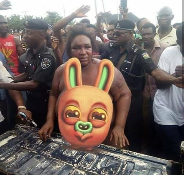 Female robber stripped and disgraced alongside her accomplices after they were caught robbing along Benin-Auchi road