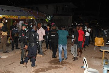 Bar owner and his customers arrested for violating lockdown order in Lagos (photos)