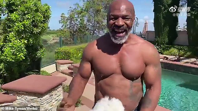 53 year old Mike Tyson shows off toned physique and abs while throwing punches as he prepares for boxing comeback (Photos/video)