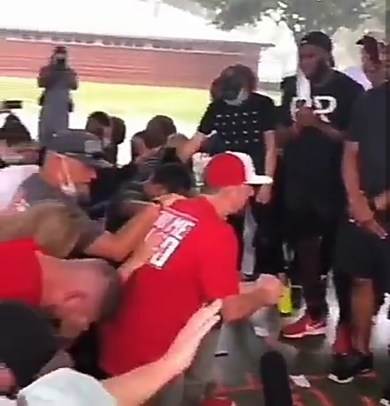 Watch moment Whites kneel before Blacks begging for forgiveness over years of racism