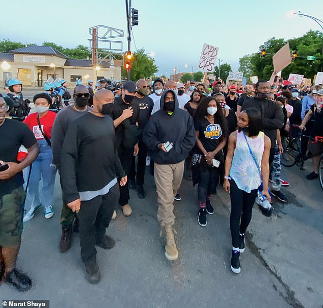 Kanye West joins protestors to march round streets of Chicago, hours after donating $2m to families of George Floyd, Breonna Taylor and Ahmaud Arbery (photos/video)
