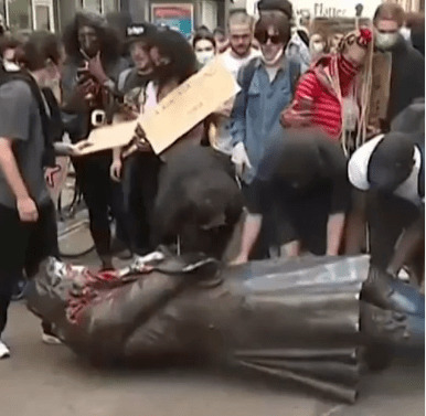 Black Lives Matter protesters in England destroy a more than 100-year-old statue honoring slave trader