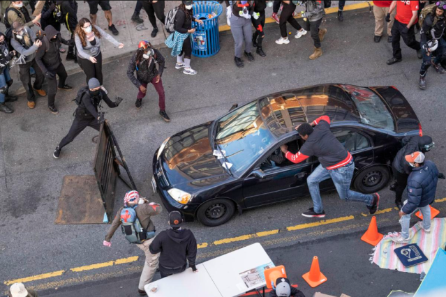 Gun-wielding man drives into protest and shoots one protester in Seattle (video)