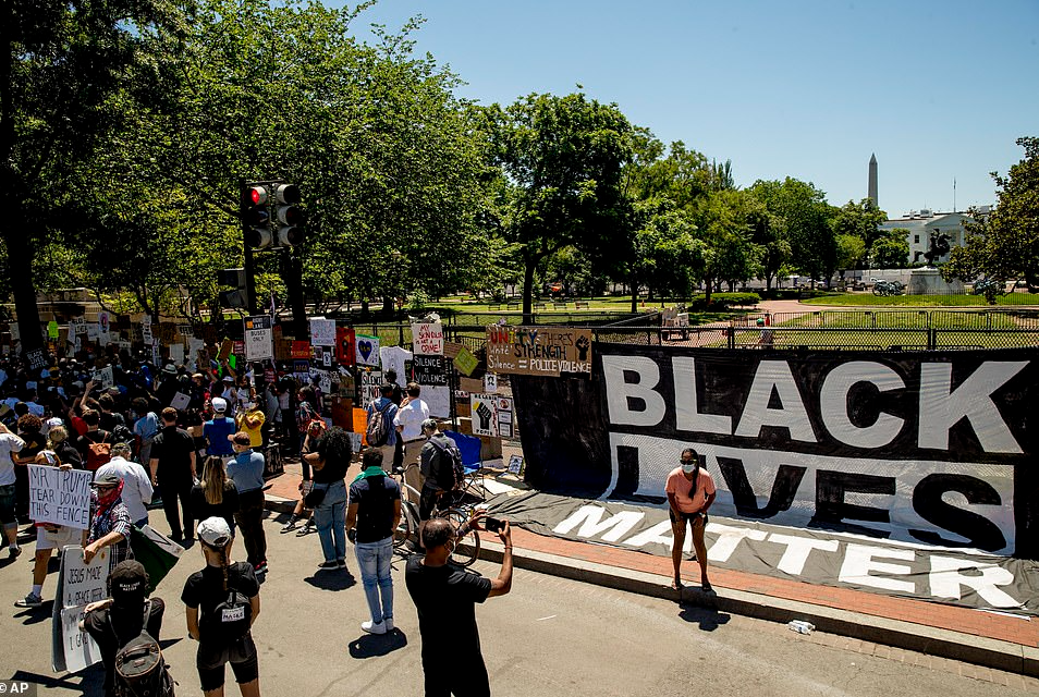 Black Lives Matter protesters turn new White House fence to mural