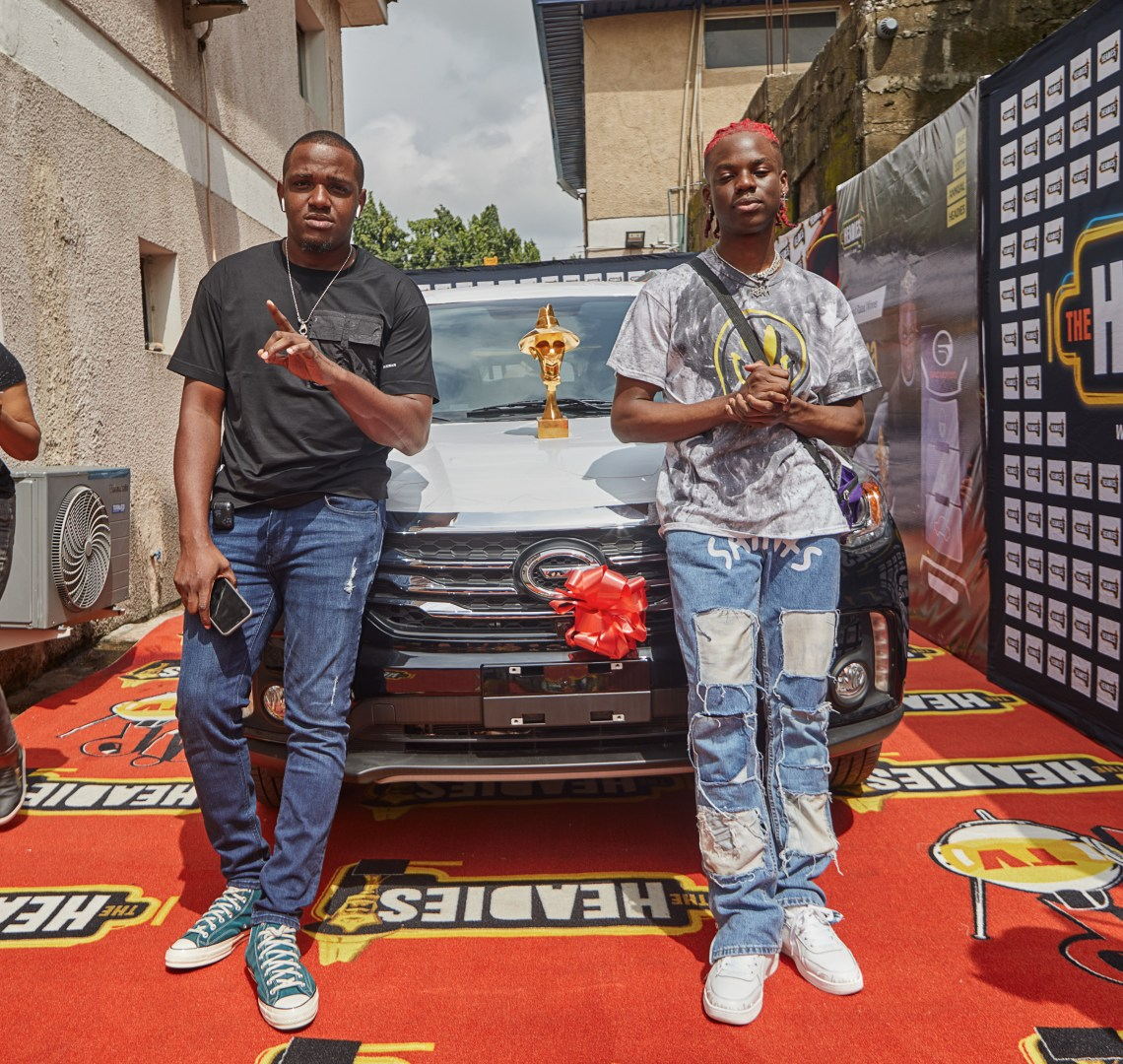 REMA & his Manager Super Sean All Smiles as the artist picks up his Next Rated Car from Headies Awards Organizers