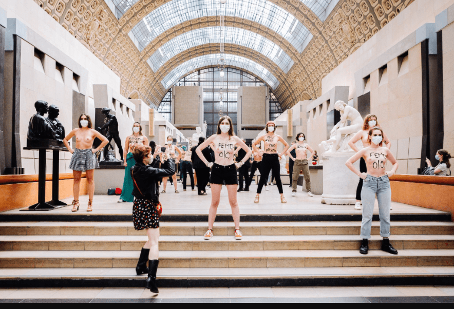 Feminists pose topless to protest after a woman was denied entry to museum over