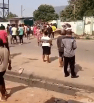 Looters invade Abuja NYSC camp, cart away mattresses and bags of rice (videos)