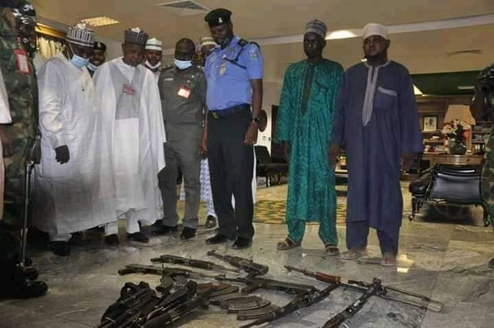 Two repentant commanders of notorious bandit syndicates terrorizing Katsina State surrender ten AK 47 rifles to Governor Masari