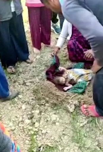 Newborn baby rescued after being found buried alive on an Indian farm