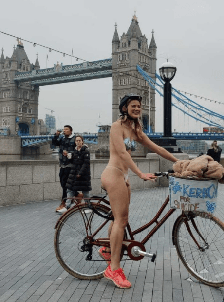 Woman cycles around London without clothes for charity after flatmate