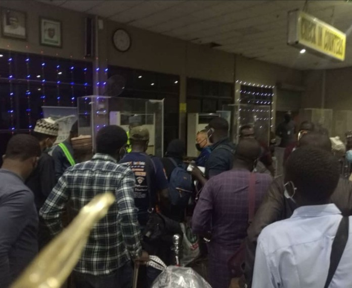 Passengers and airline staff fight over flight cancellation